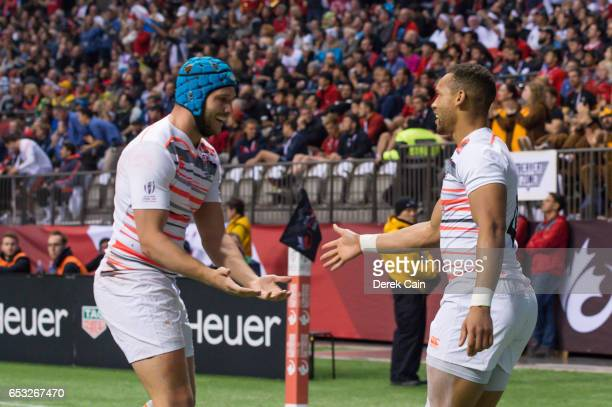 Dan Norton is congratulated by Richard de Carpentier of England after scoring a try against South Africa during the Cup Final on day 2 of the 2017...
