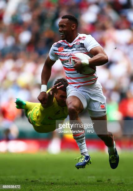 Dan Norton of England avoids a tackle from Alex Gibbon of Australia during the match between England and Australia during day one of the HSBC London...