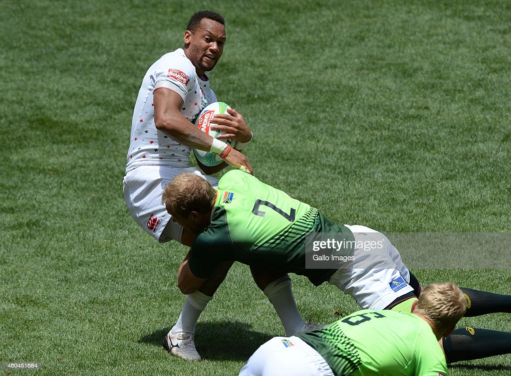 <a gi-track='captionPersonalityLinkClicked' href=/galleries/search?phrase=Dan+Norton+-+Rugby+Union+Player&family=editorial&specificpeople=12892328 ng-click='$event.stopPropagation()'>Dan Norton</a> of England gets tackled by Philip Snyman of South Africa during day 2 of the Cell C Nelson Mandela Bay Sevens Series at Nelson Mandela Bay Stadium on December 14, 2014 in Port Elizabeth, South Africa.