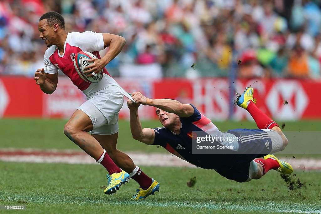 Dan Norton of England is tackled during the Bowl Quarter Final match between England and France during day three of the 2013 Hong Kong Sevens at Hong...