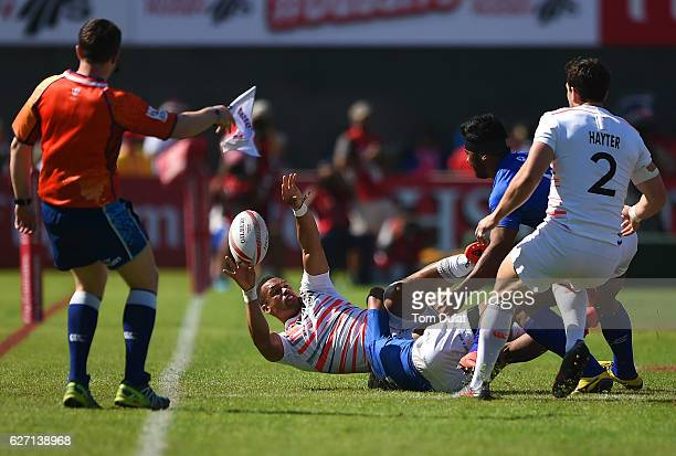 Dan Norton of England passes the ball during day two of the Emirates Dubai Rugby Sevens HSBC Sevens World Series match between England and Samoa on...