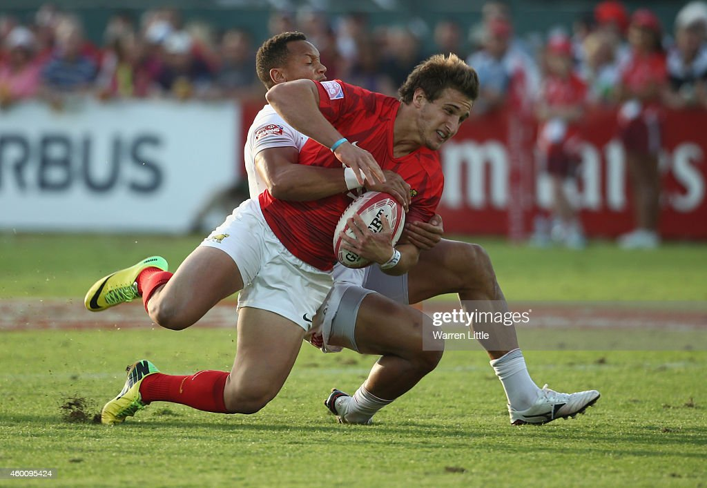 <a gi-track='captionPersonalityLinkClicked' href=/galleries/search?phrase=Dan+Norton+-+Rugby+Union+Player&family=editorial&specificpeople=12892328 ng-click='$event.stopPropagation()'>Dan Norton</a> of England tackled Segundo Tuculet of Argentina during day two of the Emirates Dubai Sevens - HSBC Sevens World Series at The Sevens Stadium on December 6, 2014 in Dubai, United Arab Emirates.