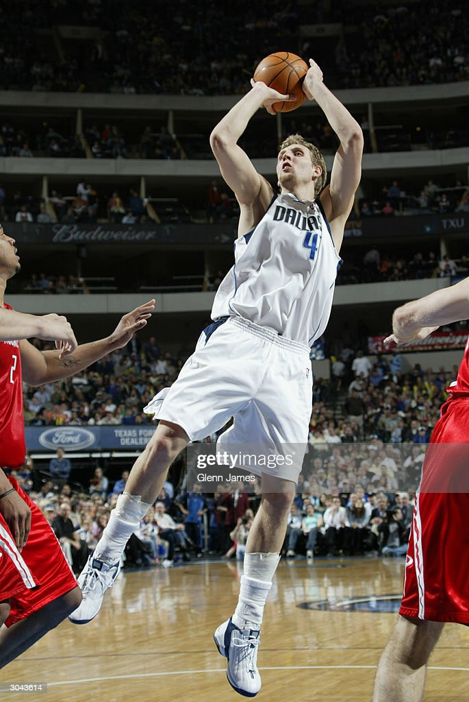Dan Nowitzki #41 of the Dallas Mavericks shoots a jumper during the game against the Houston Rockets at the American Airlines Arena on February 21, 2004 in Dallas, Texas. The Mavericks won 97-88.