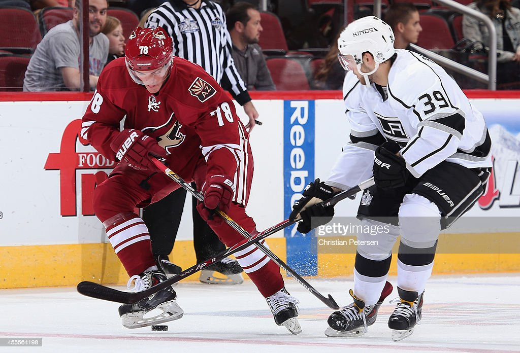 Dan O'Donoghue #78 of the Arizona Coyotes skates with the puck under pressure from Taylor Burke #39 of the Los Angeles Kings during the NHL rookie camp game at Gila River Arena on September 16, 2014 in Glendale, Arizona.