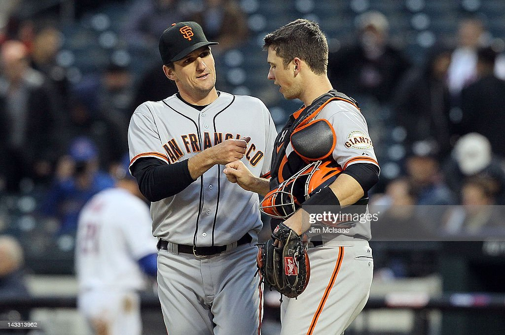 Dan Otero #37 and <a gi-track='captionPersonalityLinkClicked' href=/galleries/search?phrase=Buster+Posey&family=editorial&specificpeople=4896435 ng-click='$event.stopPropagation()'>Buster Posey</a> #28 of the San Francisco Giants celebrate after defeating the New York Mets at Citi Field on April 23, 2012 in the Flushing neighborhood of the Queens borough of New York City.