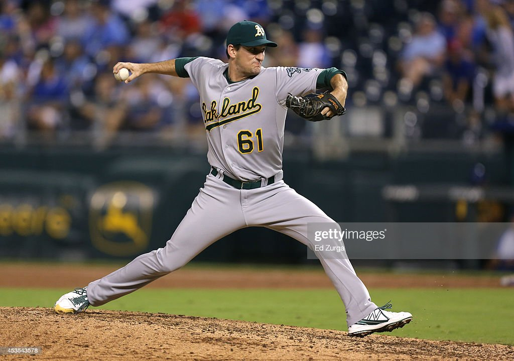 Dan Otero #61 of the Oakland Athletics pitches in the eighth inning during a game against the Kansas City Royals at Kauffman Stadium on August 12, 2014 in Kansas City, Missouri.