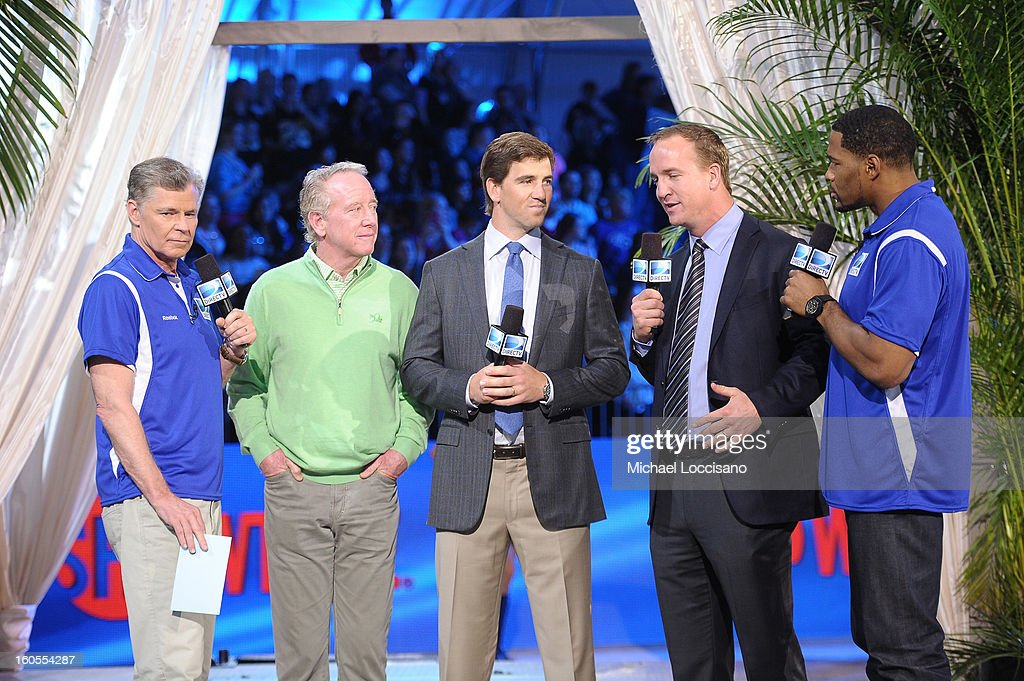 Dan Patrick, Archie Manning, Eli Manning, Peyton Manning and Michael Strahan attend DIRECTV'S Seventh Annual Celebrity Beach Bowl at DTV SuperFan Stadium at Mardi Gras World on February 2, 2013 in New Orleans, Louisiana.
