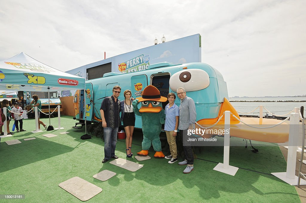 FERB - Dan Povenmire (creator/executive producer & 'Dr. Doofenshmirtz'), Jeff 'Swampy' Marsh (creator/executive producer & 'Major Monogram'), Vincent Martella ('Phineas'), Alyson Stoner ('Isabella') and Perry the Platypus from Disney's Emmy Award-winning animated series 'Phineas and Ferb' meet fans during the 'Perry the Platy-bus On Tour' stop at Chicago's Navy Pier. During the Platy-bus experience, fans of the hit series can virtually interact with characters from the show via augmented reality. Agent P's fate is revealed in the suspense-filled finale of the two-part 'Phineas and Ferb' special 'Where's Perry,' premiering Friday, August 24 on Disney Channel. DAN POVENMIRE (CREATOR/EXECUTIVE PRODUCER, 'PHINEAS AND FERB'), ALYSON STONER, PERRY THE PLATYPUS, VINCENT MARTELLA, JEFF 'SWAMPY' MARSH