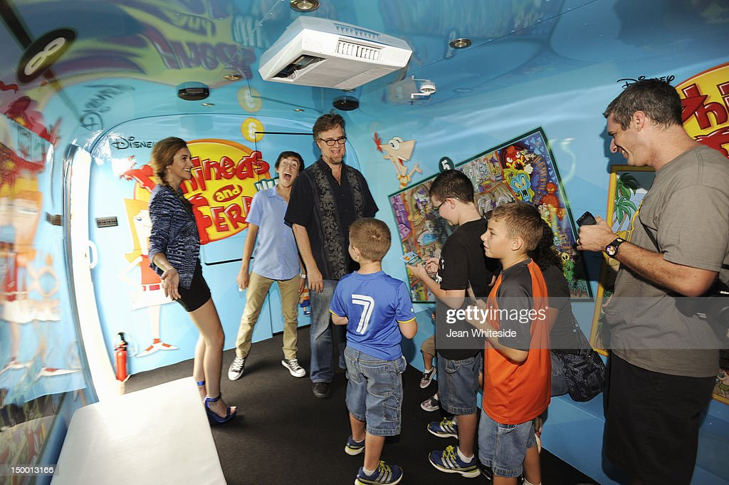 FERB - Dan Povenmire (creator/executive producer & 'Dr. Doofenshmirtz'), Jeff 'Swampy' Marsh (creator/executive producer & 'Major Monogram'), Vincent Martella ('Phineas'), Alyson Stoner ('Isabella') and Perry the Platypus from Disney's Emmy Award-winning animated series 'Phineas and Ferb' meet fans during the 'Perry the Platy-bus On Tour' stop at Chicago's Navy Pier. During the Platy-bus experience, fans of the hit series can virtually interact with characters from the show via augmented reality. Agent P's fate is revealed in the suspense-filled finale of the two-part 'Phineas and Ferb' special 'Where's Perry,' premiering Friday, August 24 on Disney Channel. ALYSON