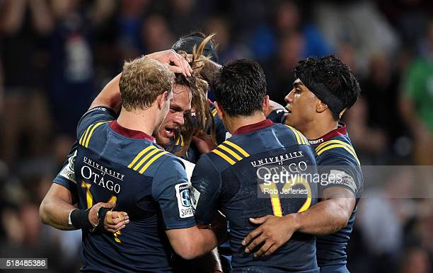 Dan Pryor of the Highlanders celebrates with his teammates after scoring a try during the round six Super Rugby match between the Highlanders and the...