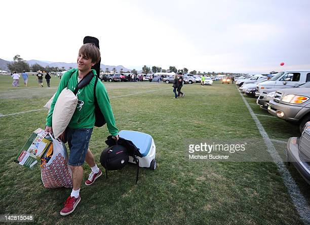 Dan Rambles of Los Angeles Calif walks with his luggage in the car camping zone of the 2012 Coachella Music Festival on the Empire Polo Fields on...