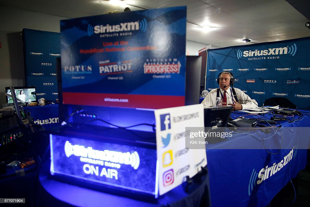 Dan Rather talks with Jonathan Alter while hosting his show Dan Rather's America on SiriusXM at Quicken Loans Arena on July 18 2016 in Cleveland Ohio
