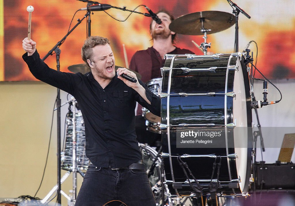<a gi-track='captionPersonalityLinkClicked' href=/galleries/search?phrase=Dan+Reynolds&family=editorial&specificpeople=8995077 ng-click='$event.stopPropagation()'>Dan Reynolds</a> and Dan Platzman of <a gi-track='captionPersonalityLinkClicked' href=/galleries/search?phrase=Imagine+Dragons&family=editorial&specificpeople=8995078 ng-click='$event.stopPropagation()'>Imagine Dragons</a> perform at ABC's 'Good Morning America' at Rumsey Playfield, Central Park on July 5, 2013 in New York City.