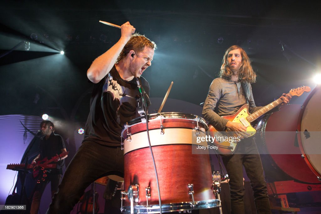 <a gi-track='captionPersonalityLinkClicked' href=/galleries/search?phrase=Dan+Reynolds&family=editorial&specificpeople=8995077 ng-click='$event.stopPropagation()'>Dan Reynolds</a> (C) of Imagine Dragons performs at the Egyptian Room at Old National Centre on February 28, 2013 in Indianapolis, Indiana.