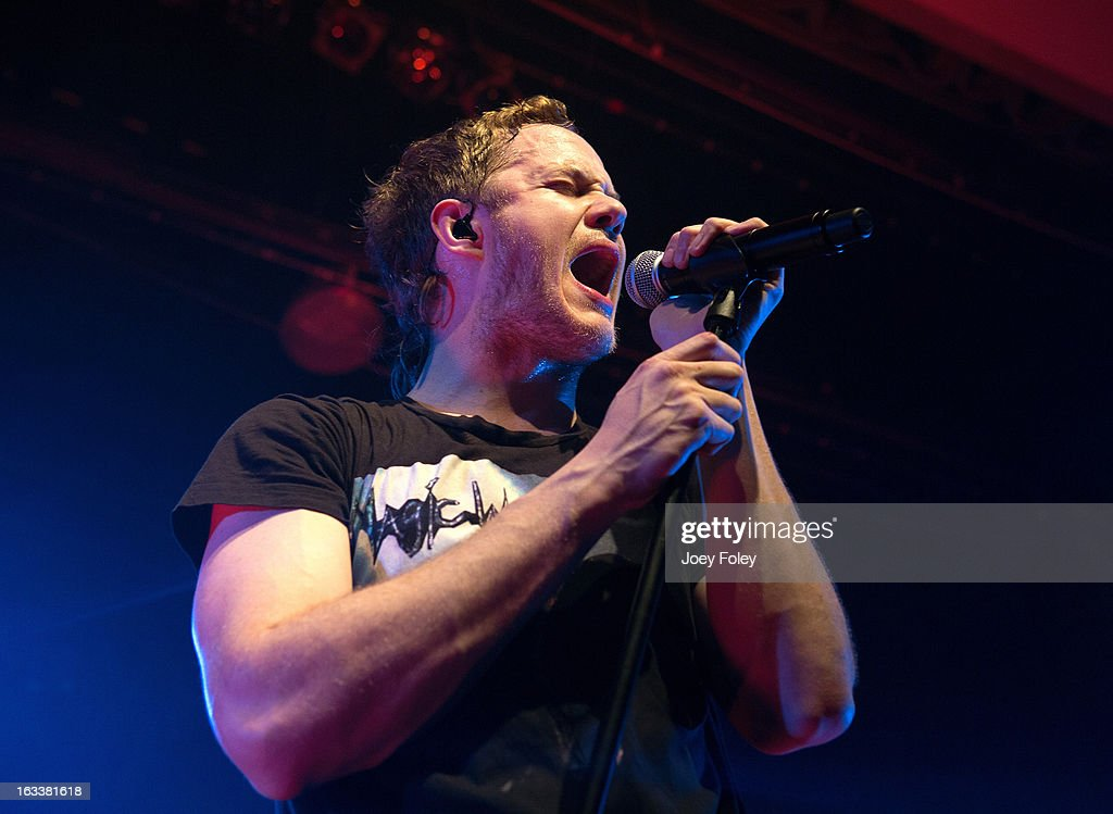 <a gi-track='captionPersonalityLinkClicked' href=/galleries/search?phrase=Dan+Reynolds&family=editorial&specificpeople=8995077 ng-click='$event.stopPropagation()'>Dan Reynolds</a> of Imagine Dragons performs at the Egyptian Room at Old National Centre on February 28, 2013 in Indianapolis, Indiana.