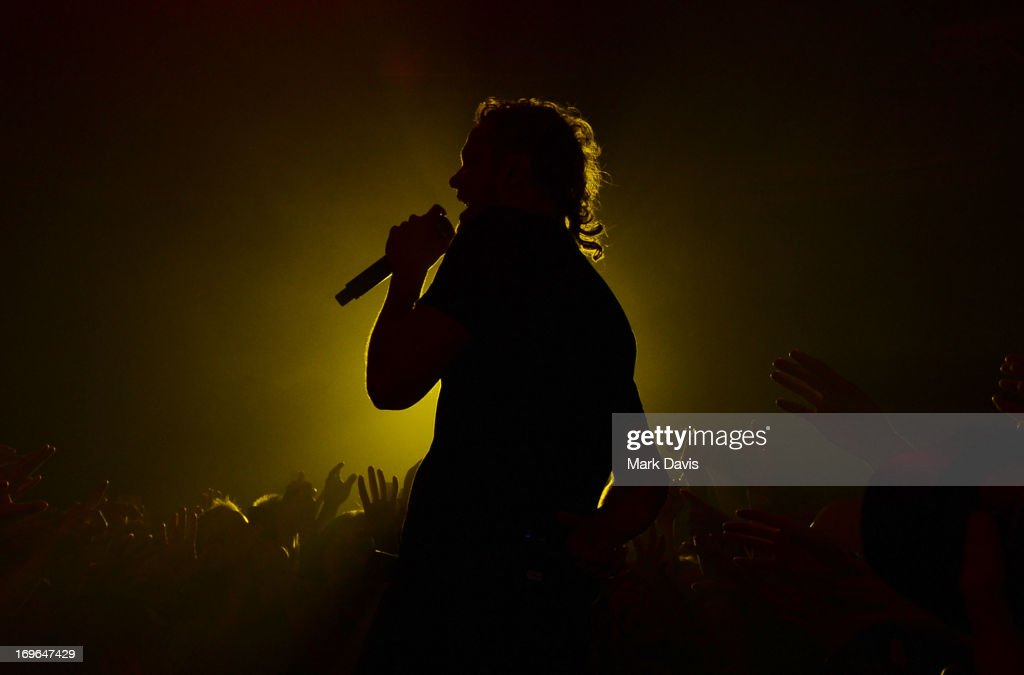 <a gi-track='captionPersonalityLinkClicked' href=/galleries/search?phrase=Dan+Reynolds&family=editorial&specificpeople=8995077 ng-click='$event.stopPropagation()'>Dan Reynolds</a> of Imagine Dragons performs at the Hollywood Palladium on May 29, 2013 in Hollywood, California.