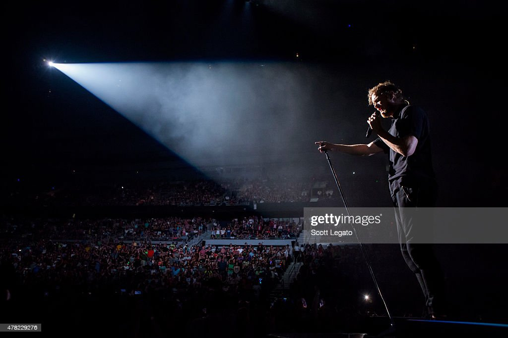 Dan Reynolds of Imagine Dragons performs during the Smoke Mirros Tour on June 23 2015 in Auburn Hills Michigan