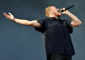 Dan Reynolds of Imagine Dragons performs on Day 3 of the Leeds Festival at Bramham Park on August 24 2014 in Leeds England