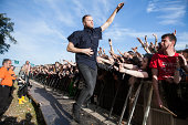 Dan Reynolds of Imagine Dragons performs on stage at Leeds Festival at Bramham Park on August 24 2014 in Leeds United Kingdom