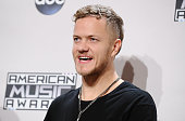 Dan Reynolds of Imagine Dragons poses in the press room at the 2014 American Music Awards at Nokia Theatre LA Live on November 23 2014 in Los Angeles...