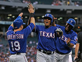 Dan Robertson Adrian Beltre and Elvis Andrus of the Texas Rangers celebrate scoring runs in the 2nd inning against the Chicago White Sox at US...