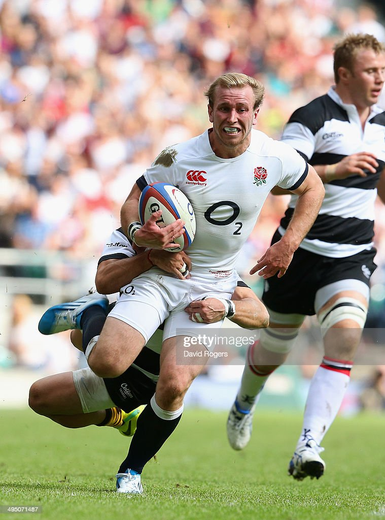 Dan Robson of England is tackled during the Rugby Union International Match between England and The Barbarians at Twickenham Stadium on June 1, 2014 in London, England.
