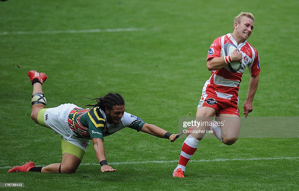 Dan Robson of Gloucester gets away from Mike Teo of San Francisco to score a try during the Plate Semi Final match between Gloucester Rugby and San Francisco in the World Club 7's at Twickenham Stadium on August 18, 2013 in London, England.