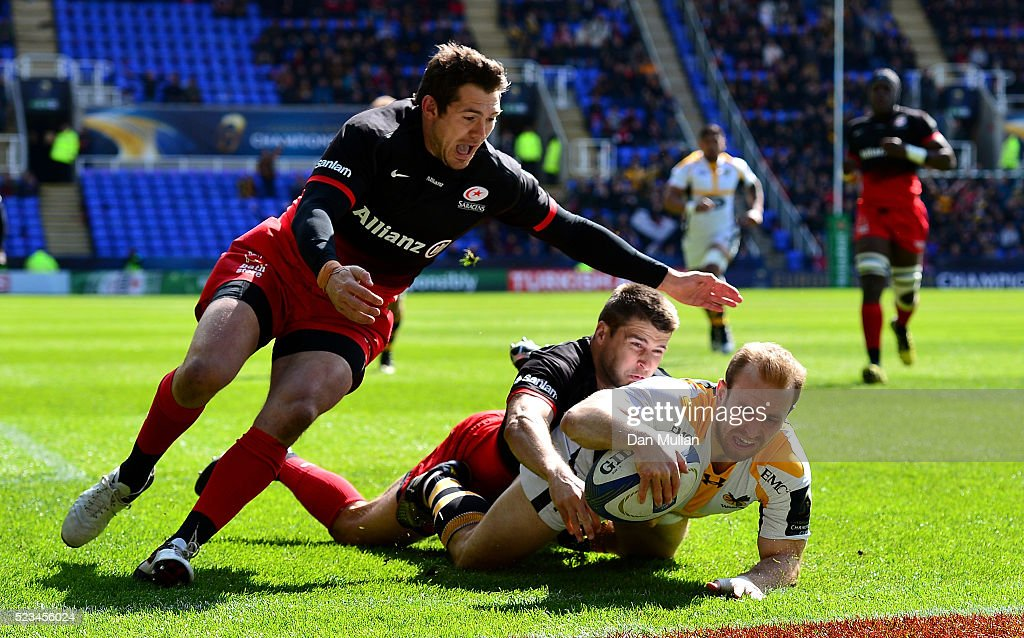 Dan Robson of Wasps dives over for his side's first try under pressure from <a gi-track='captionPersonalityLinkClicked' href=/galleries/search?phrase=Richard+Wigglesworth&family=editorial&specificpeople=553815 ng-click='$event.stopPropagation()'>Richard Wigglesworth</a> of Saracens and <a gi-track='captionPersonalityLinkClicked' href=/galleries/search?phrase=Alex+Goode&family=editorial&specificpeople=2060375 ng-click='$event.stopPropagation()'>Alex Goode</a> of Saracens during the European Rugby Champions Cup Semi Final between Saracens and Wasps at the Madejski Stadium on April 23, 2016 in Reading, England.