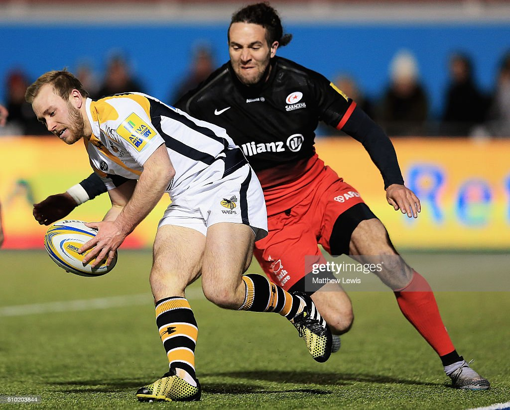 Dan Robson of Wasps scores a try during the Aviva Premiership match between Saracens and Wasps at Allianz Park on February 14, in Barnet, England.