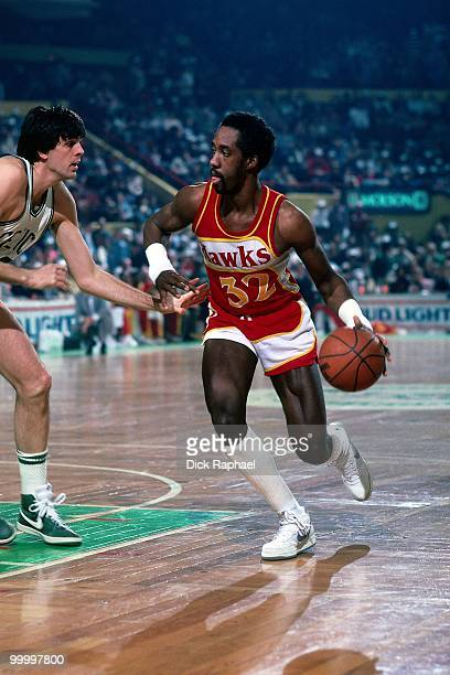 Dan Roundfield of the Atlanta Hawks drives to the basket against Kevin McHale of the Boston Celtics during a game played in 1983 at the Boston Garden...