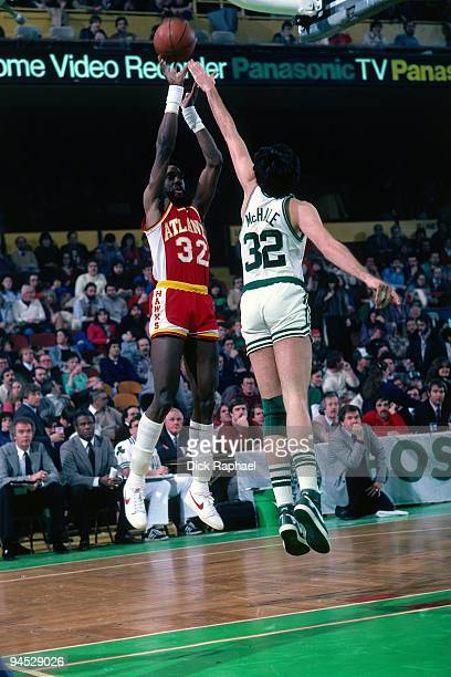 Dan Roundfield of the Atlanta Hawks shoots a jump shot against Kevin McHale of the Boston Celtics during a game played in 1982 at the Boston Garden...