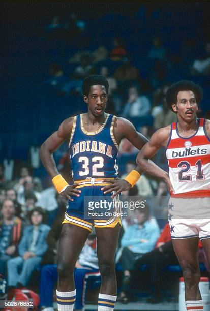 Dan Roundfield of the Indiana Pacers looks on with Dave Bing of the Washington Bullets during an NBA basketball game circa 1978 at the Capital Centre...