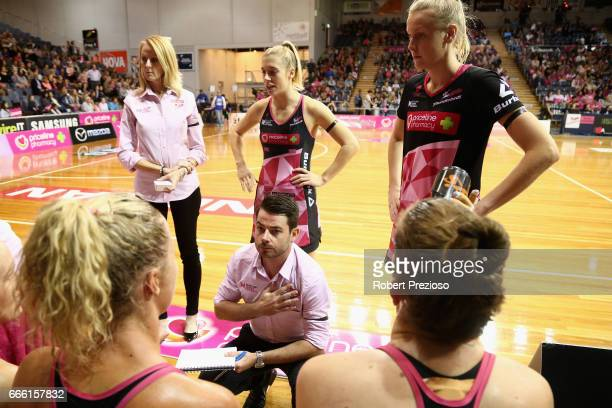 Dan Ryan coach of the Thunderbirds speaks to players during the round eight Super Netball match between the Thunderbirds and the Vixens at Priceline...
