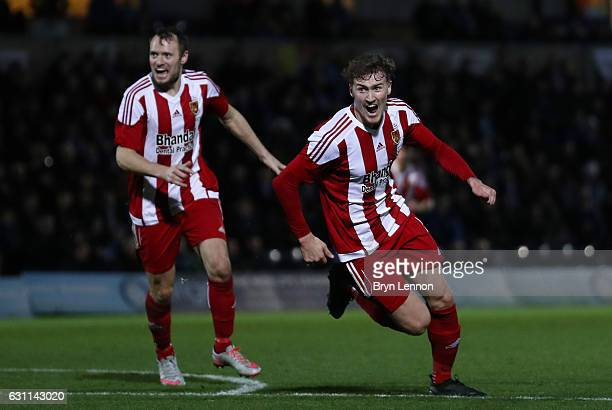 Dan Scarr of Stourbridge celebrates scoring his sides first goal during the Emirates FA Cup Third Round match between Wycombe Wanderers and...
