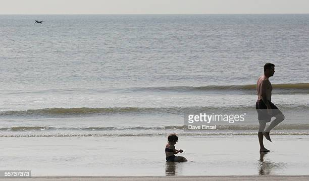 Dan Schultz of Philadelphia plays with his daughter Madelyn on the beach September 21 2005 in Galveston Texas Schutlz and his family are visiting his...