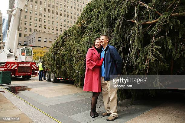 Dan Sigafoos and Rachel DrosdickSigafoos pose in front of the Rockefeller Center's Christmas tree which was cut down from their proerty in central...