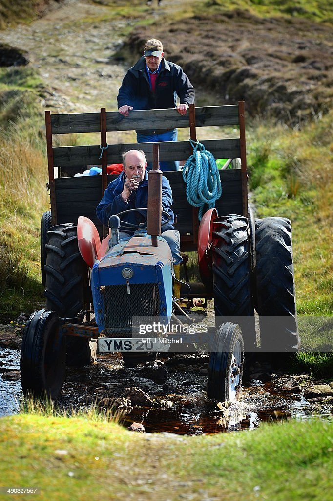 Dan Smith and Alastair Maclean finish a day extracting peat from a moor near the village of Cross on May 13, 2014 in Lewis, Scotland. The tradition of peat cutting has seen a revival over recent years in the Outer Hebrides as residents conscious of rising fuel cost are using it to run their central heating and stove fires. A referendum on whether Scotland should be an independent country will take place on September 18, 2014.