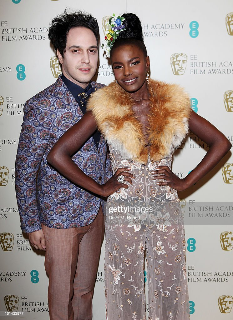 Dan Smith (L) and Shingai Shinowa arrive at the after party following the EE British Academy Film Awards at Grosvenor House on February 10, 2013 in London, England.