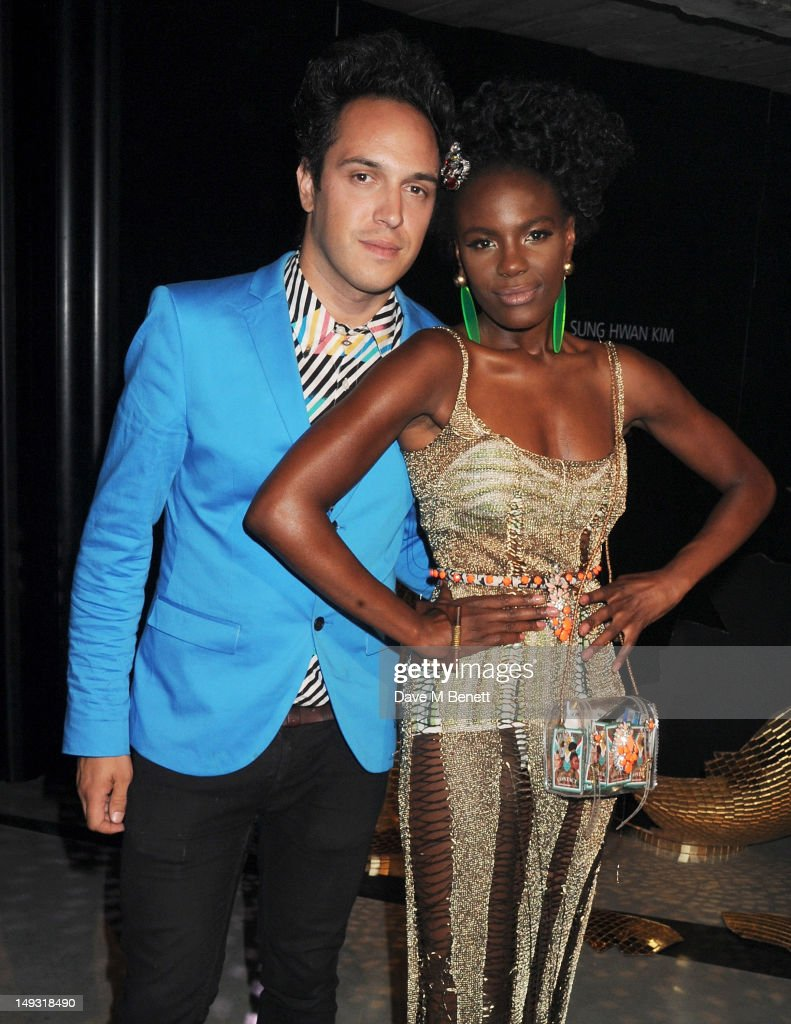 Dan Smith (L) and <a gi-track='captionPersonalityLinkClicked' href=/galleries/search?phrase=Shingai+Shoniwa&family=editorial&specificpeople=4266140 ng-click='$event.stopPropagation()'>Shingai Shoniwa</a> attend the Warner Music Group Pre-Olympics Party in the Southern Tanks Gallery at the Tate Modern on July 26, 2012 in London, England