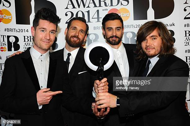 Dan Smith Chris 'Woody' Wood Kyle Simmons and Will Farquarson of Bastille winner of the British Breakthrough Act award pose in the winners room at...