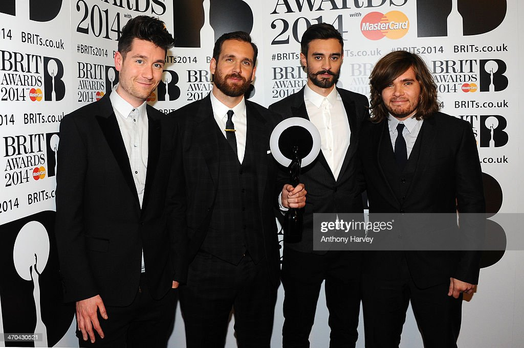 Dan Smith, Chris 'Woody' Wood, <a gi-track='captionPersonalityLinkClicked' href=/galleries/search?phrase=Kyle+Simmons+-+Musician&family=editorial&specificpeople=9756970 ng-click='$event.stopPropagation()'>Kyle Simmons</a> and <a gi-track='captionPersonalityLinkClicked' href=/galleries/search?phrase=Will+Farquarson+-+Musician&family=editorial&specificpeople=10542444 ng-click='$event.stopPropagation()'>Will Farquarson</a> of Bastille, winner of the British Breakthrough Act award, pose in the winners room at The BRIT Awards 2014 at 02 Arena on February 19, 2014 in London, England.