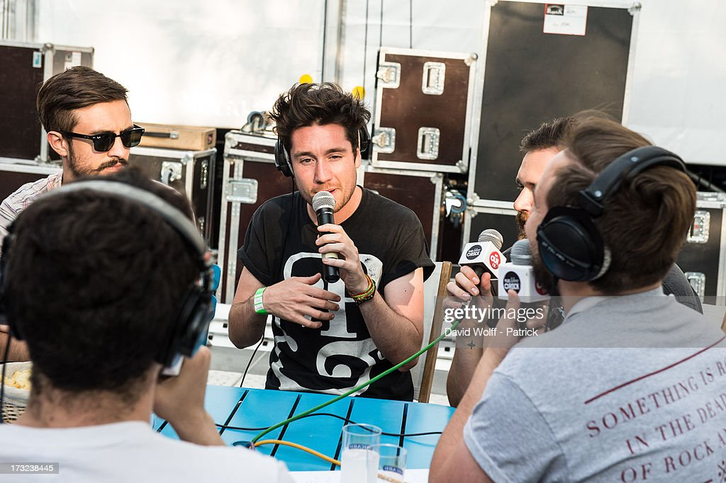 Dan Smith from Bastille is being interviewed by radio station at place de la republique on July 10, 2013 in Paris, France.