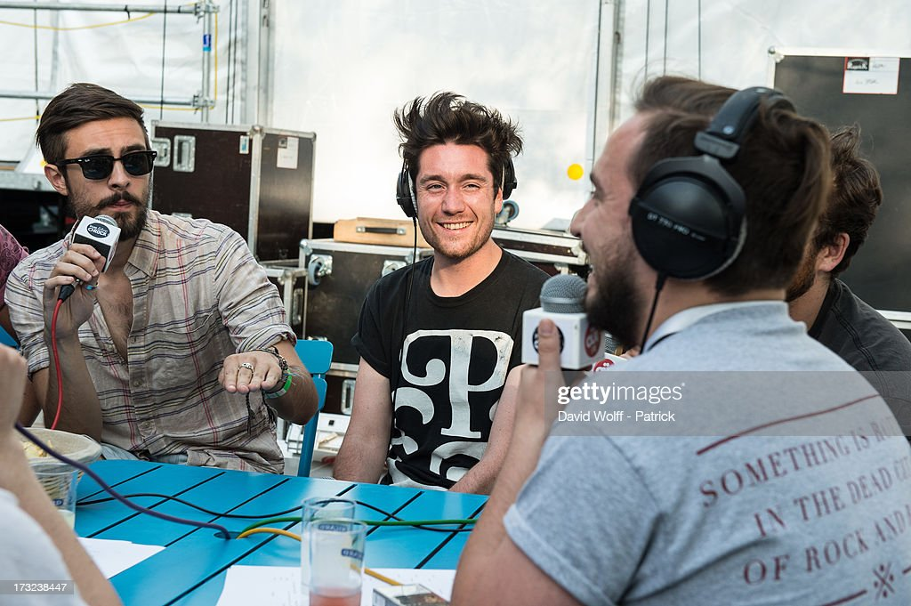 Dan Smith from Bastille (C) is being interviewed by radio station at place de la republique on July 10, 2013 in Paris, France.