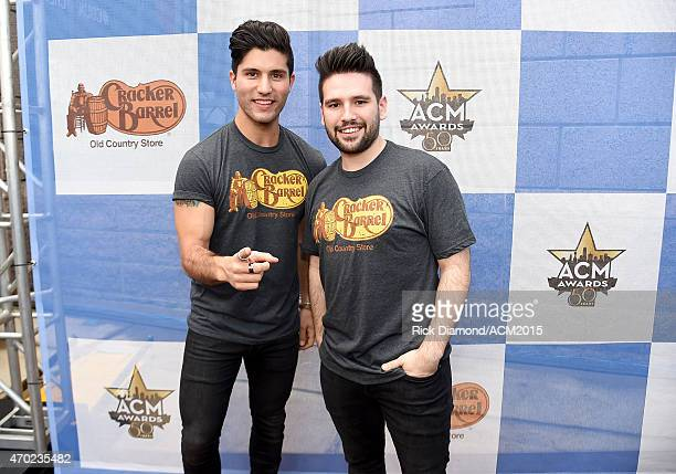 Dan Smyers and Shay Mooney of Dan Shay attend the Cracker Barrel Old Country Store Country Checkers Challenge at Globe Life Park in Arlington on...
