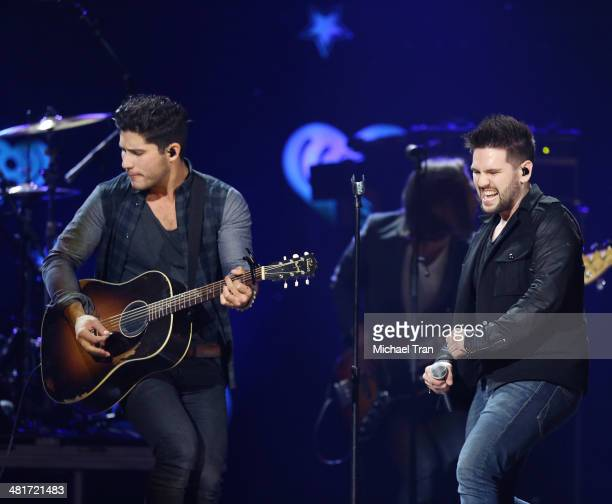 Dan Smyers and Shay Mooney of Dan Shay perform onstage during the iHeartRadio Country Festival at the Frank Erwin Center on March 29 2014 in Austin...