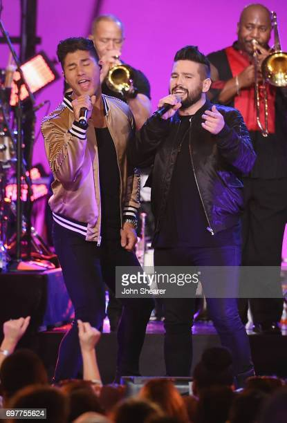 Dan Smyers and Shay Mooney of Dan Shay perform onstage with Earth Wind Fire during CMT Crossroads Earth Wind Fire and Friends on June 6 2017 in...