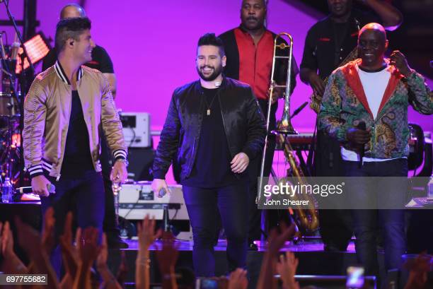 Dan Smyers and Shay Mooney of Dan Shay perform onstage with Philip Bailey of Earth Wind Fire during CMT Crossroads Earth Wind Fire and Friends on...