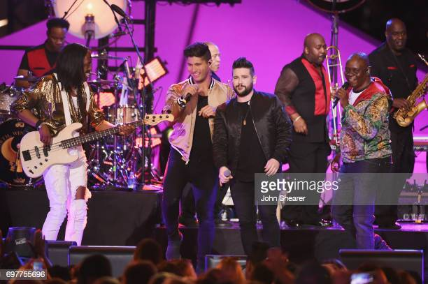 Dan Smyers and Shay Mooney of Dan Shay perform onstage with Verdine White and Philip Bailey of Earth Wind Fire during CMT Crossroads Earth Wind Fire...