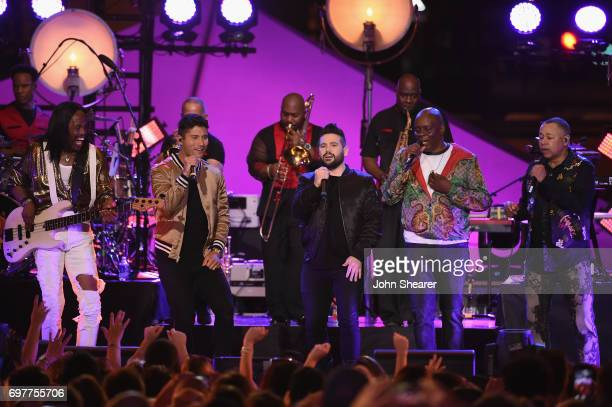 Dan Smyers and Shay Mooney of Dan Shay perform onstage with Verdine White Philip Bailey and Ralph Johnson of Earth Wind Fire during CMT Crossroads...