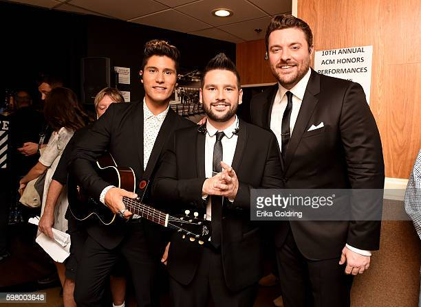 Dan Smyers and Shay Mooney of Dan Shay pose with Chris Young during the 10th Annual ACM Honors at the Ryman Auditorium on August 30 2016 in Nashville...